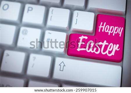 happy easter against pink enter key on keyboard