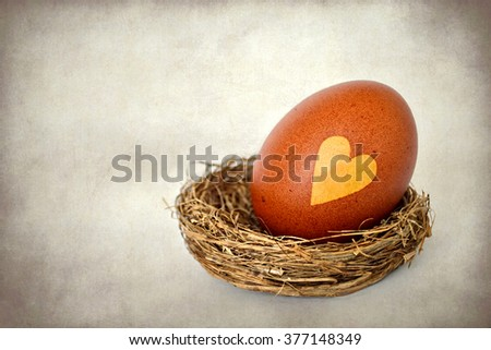 Happy Easter card: Easter egg with heart shape on it, grunge background - stock photo