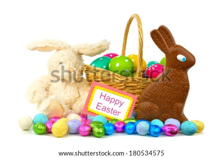 Happy Easter card with Easter basket, candies and toy bunny over white - stock photo