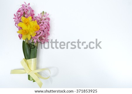 Happy Easter holiday, colored eggs, hyacinths and narcissus, copy space