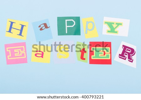Happy Easter holiday: handmade collage from colorful cut paper letters,  blue background