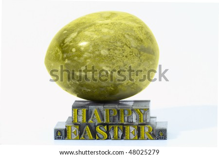 Happy easter in letterpress type and marble egg isolated on a white background. - stock photo