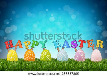 happy easter lettering with easter eggs - stock photo