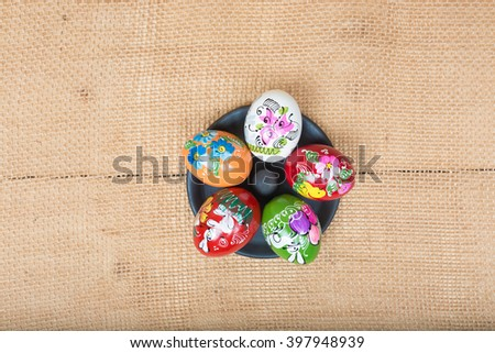 Happy easter! Painted Easter eggs on rustic background Romanian and pots