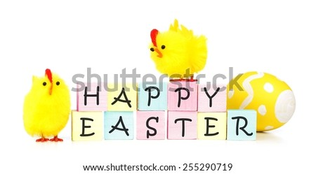 Happy Easter wooden blocks with eggs and yellow fuzzy chicks on a white background - stock photo