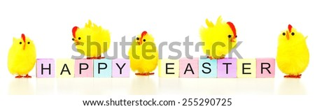 Happy Easter wooden blocks with yellow fuzzy chicks on a white background - stock photo