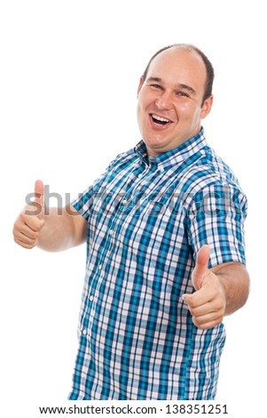 Happy ecstatic man gesturing thumbs up, isolated on white background - stock photo