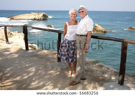 happy elderly couple having fun outdoors - stock photo