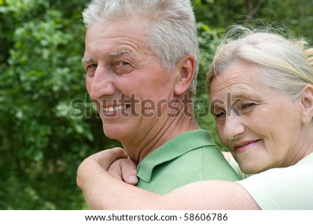 happy elderly couple in a summer park