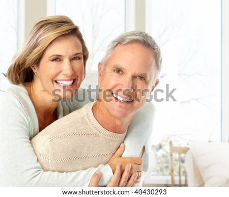 Happy elderly couple in love at home
