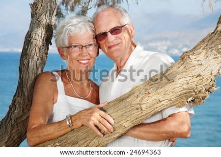 happy elderly couple in love - bright lifestyle portrait - stock photo