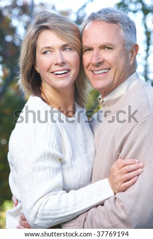 Happy elderly couple in love in park