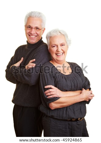 Happy elderly couple leaning on each other - stock photo