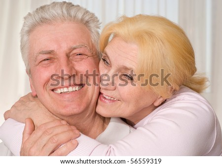 happy elderly couple together on a white background