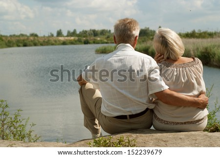 Happy elderly couple went for a walk on the nature - stock photo