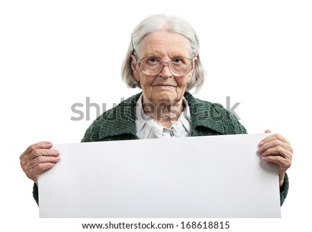 Happy elderly lady holding blank sheet in hand over white - stock photo