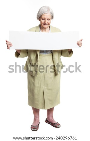 Happy elderly lady holding blank sheet in hands over white - stock photo