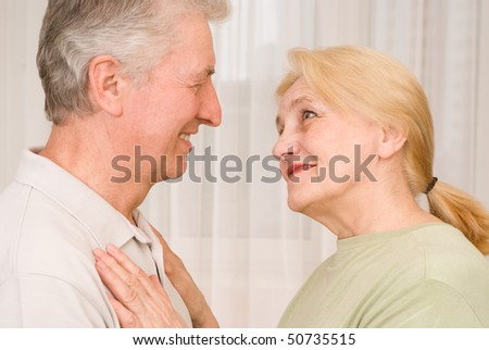 happy elderly man and woman