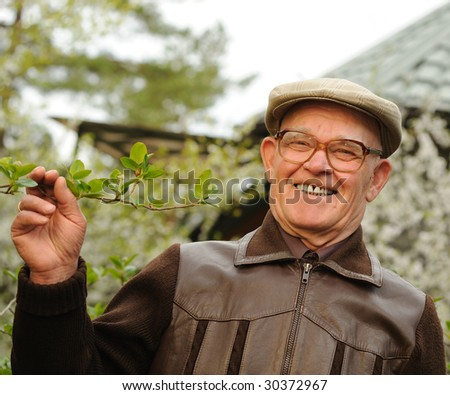 Happy elderly man in a garden