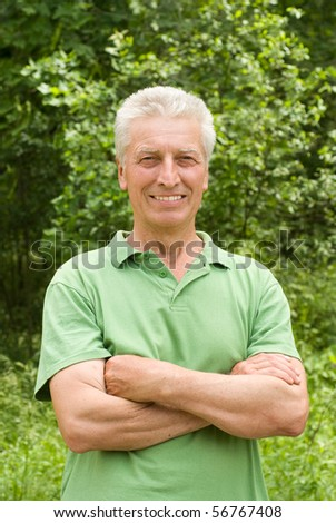 happy elderly man in a summer park
