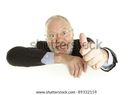 Happy elderly man is pointing thumb up on white background
