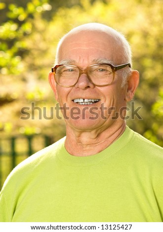 Happy elderly man outdoors - stock photo
