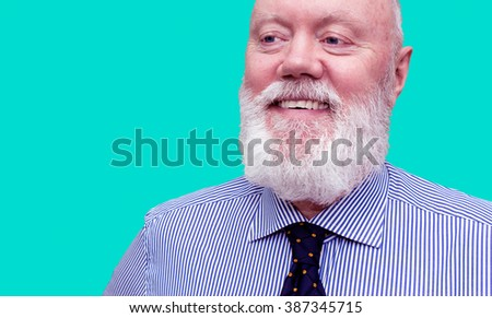 Happy elderly man, senior, is posing on blue background, color and contrast manipulated - stock photo
