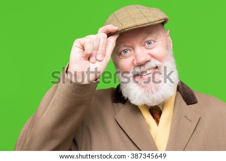 Happy elderly man, senior, is posing on green background, color and contrast manipulated - stock photo