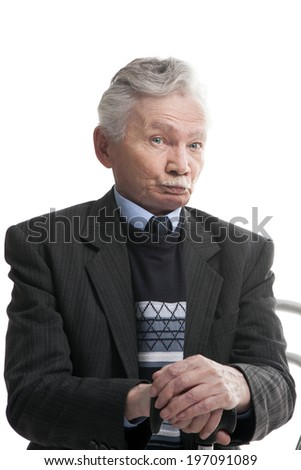 happy elderly man sitting on the chair