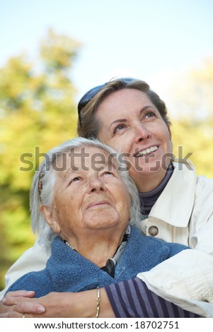 Happy elderly mother with her daughter - stock photo