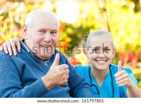 Happy elderly patient with helpful kind doctor. - stock photo