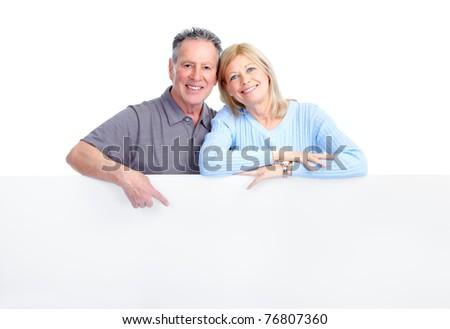 Happy elderly seniors couple in love. Isolated over white background - stock photo