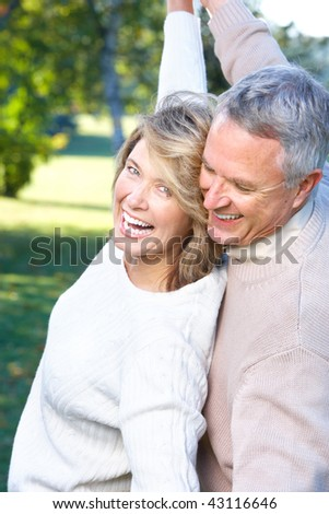 Happy elderly seniors couple in park