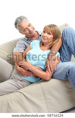 Happy elderly seniors couple. Isolated over white background - stock photo