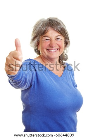 Happy elderly woman holding her thumb up - stock photo