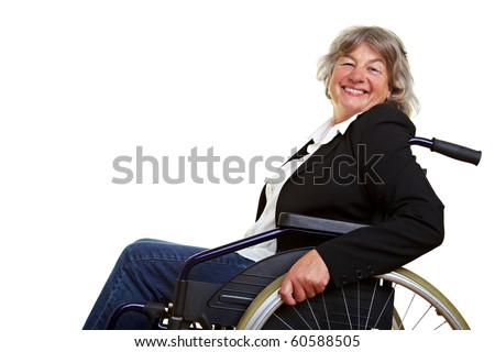 Happy elderly woman sitting in a wheelchair - stock photo