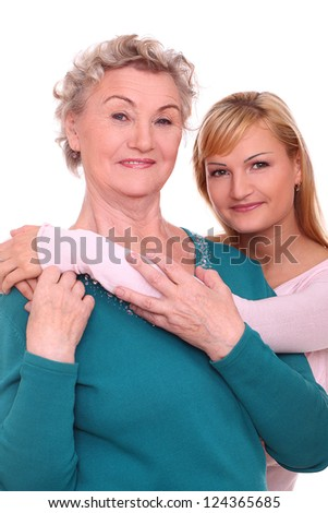 Happy elderly woman with granddaughter isolated on white background - stock photo
