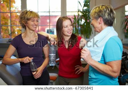 Happy elderly women talking in a gym - stock photo