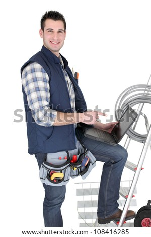 Happy electrician with his equipment on white background - stock photo