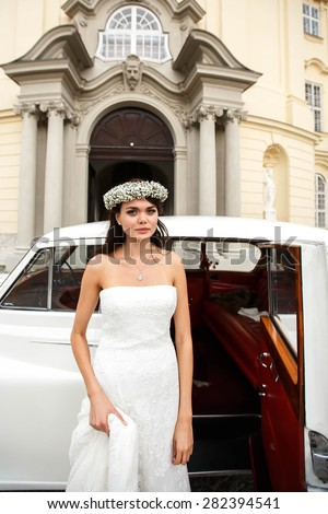 happy elegant cute stylish bride in crown on the background car and opera house - stock photo