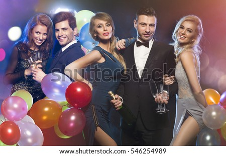 Happy elegant friends at party