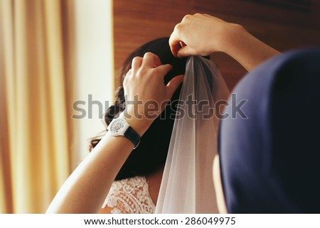happy elegant stylish luxury beautiful brunette bride preparing for marriage - stock photo