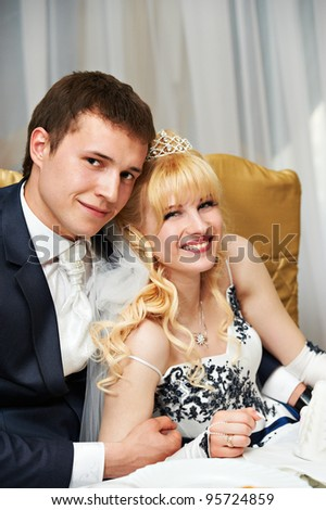 Happy embrace bride and groom in wedding day - stock photo