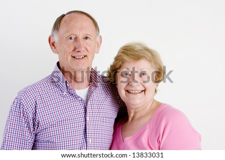 Happy embracing senior couple portrait