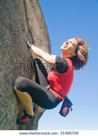Happy energetic rock climber - stock photo