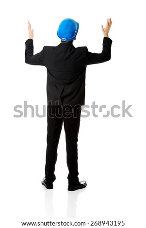 Happy engineer businessman showing empty copyspace on hands. - stock photo