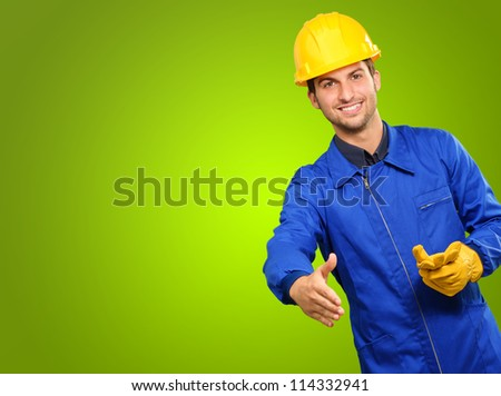 Happy Engineer Gesturing On Green Background - stock photo