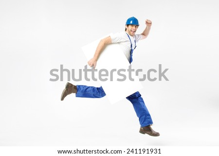 Happy engineer running with blank banner - stock photo