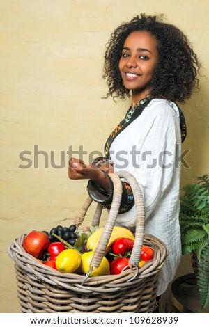 Happy Ethiopian girl wearing a traditional costume - stock photo