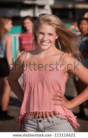 Happy European female teenager with friends outside - stock photo